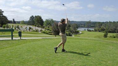 Dean Barker Tees off at Huapai Golf Club.