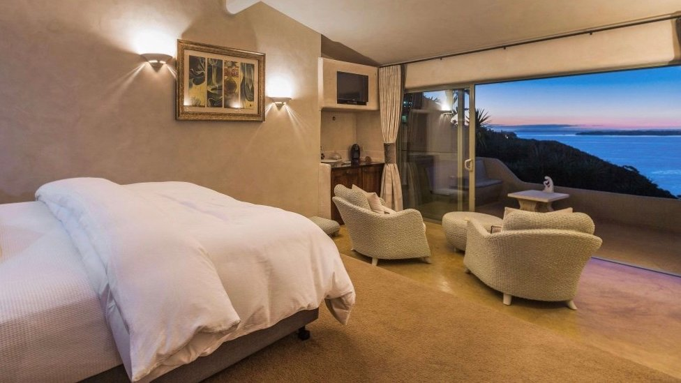 incredible sea views from the huge bed in 5 Star Delamore Lodge Hotel on Waiheke