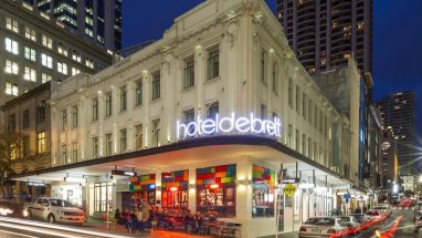 The 5 star Hotel DeBrett is one of Auckland's best Boutique Hotel in Auckland CBD light up at night.