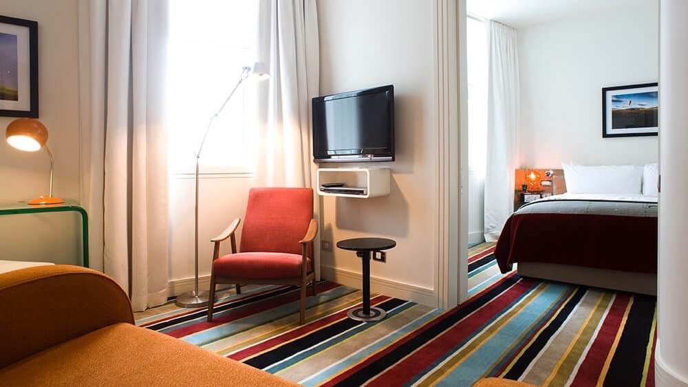 5 star boutique Hotel DeBrett suite with bright striped carpet
