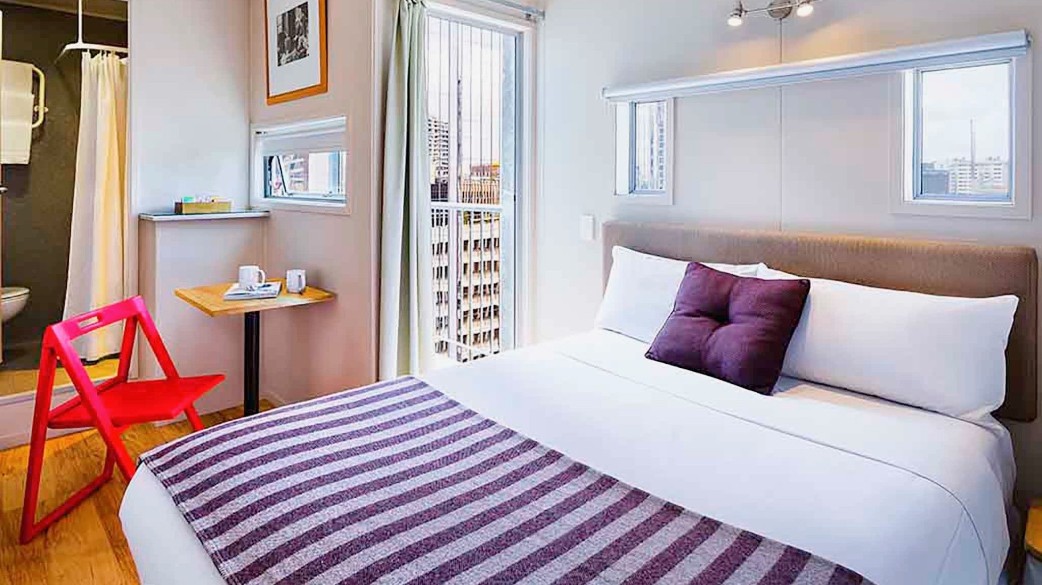 IBIS Budget Auckland CBD Hotel is a cheap 3 star hotel room with large comfy bed.