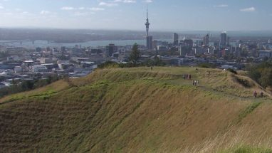 Tourists climb Mt Eden Volcanic Crater in Auckland
