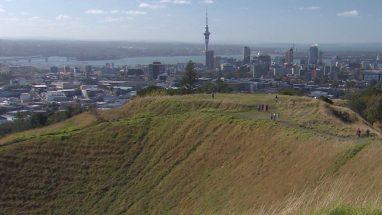 Tourists climb Mt Eden Volcanic Crater in Auckland