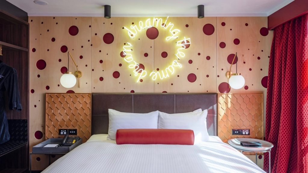 neon wall art in luxurious 5 star hotel room at Naumi Hotel Auckland Airport