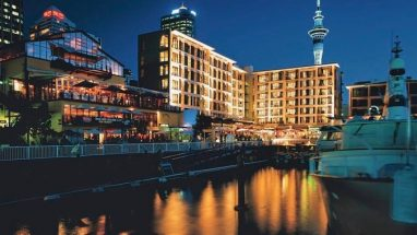 The 4 star Sebel Hotel lit up at night in Auckland's Viaduct Harbour in the CBD.