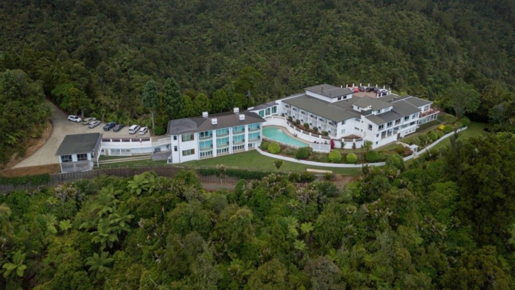 Heritage Hotel Waitakere Estate Aerial View of hotel and pool in forest