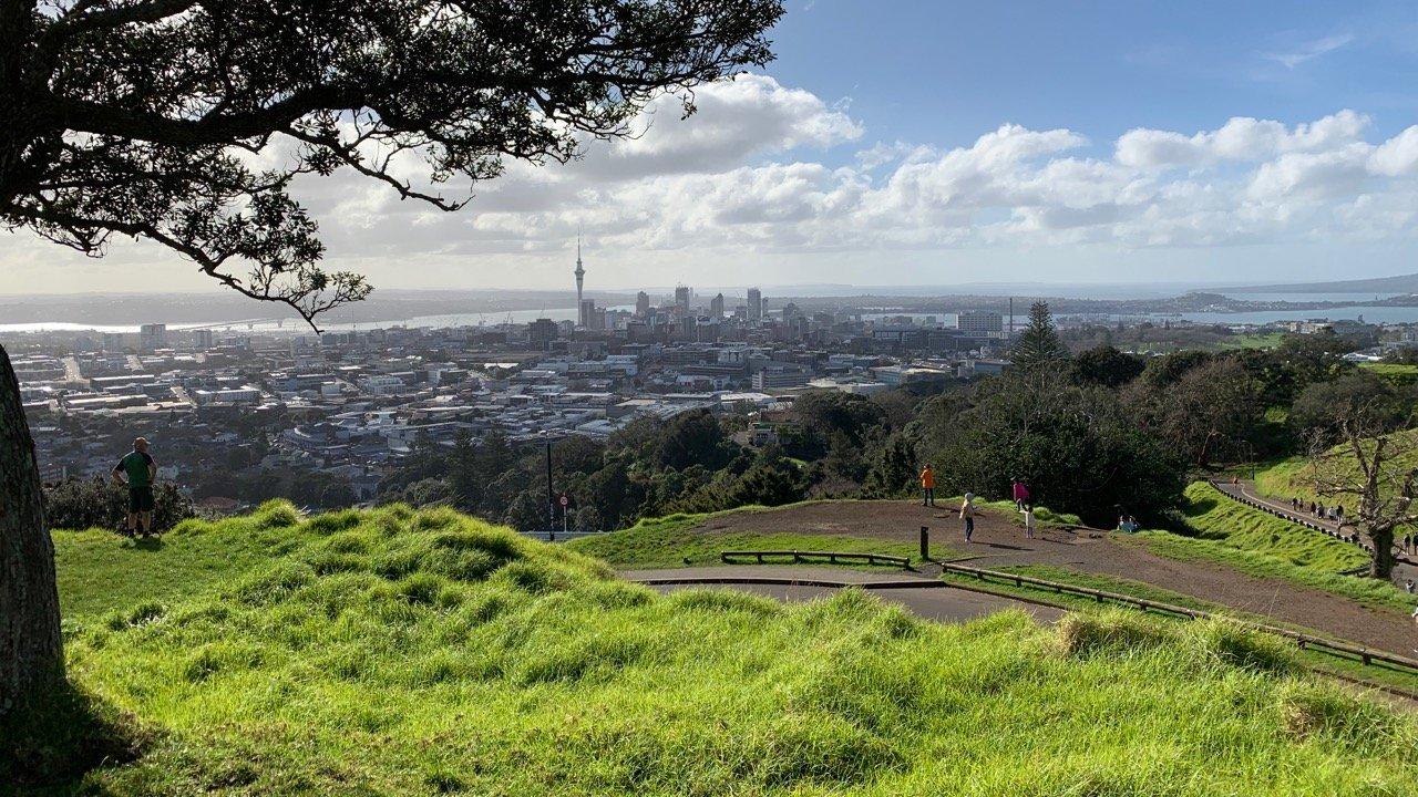 tourists enjoy city views from Mt Eden Summit